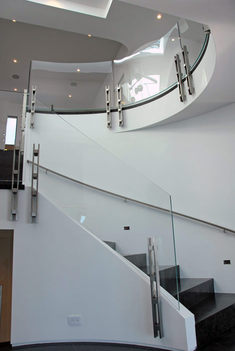 Curved Glass Rail System With Custom Stainless Steel Posts